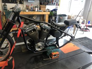 Motor, oil tank, and fender mounted.