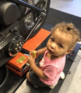 Granddaughter helping get the clutch adjusted.