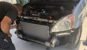 Installing the new radiator in the CRV
