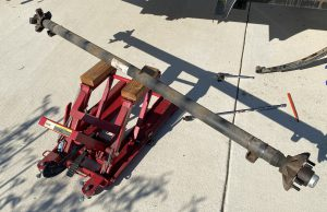 Axle removed from trailer.