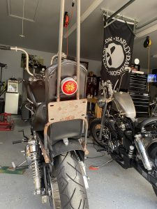 Garage built sissy bar with license plate mount and tail light.