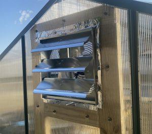 Greenhouse fan outside vent