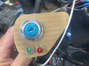 Key switch and indicator light mount mocked up on cardboard