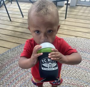 Grandson with his TC Bros Choppers Koozie