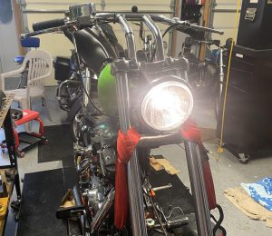 Headlight, grips, cables, and brakes.