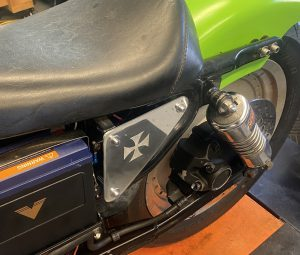 Maltese Cross Etched in the Side Cover Mounted on the Bike